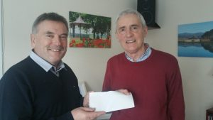 Pictured is Finbarr Keohan presenting a cheque for €1,150.00 to Solas board member, John Lawless. Proceeds from the sale of his Christmas Calendar in aid of the Solas Cancer Support Centre, West Waterford services. . The calendar features some stunning photos of West Waterford. Thank you to Finbarr and everyone who purchased a calendar on our behalf.